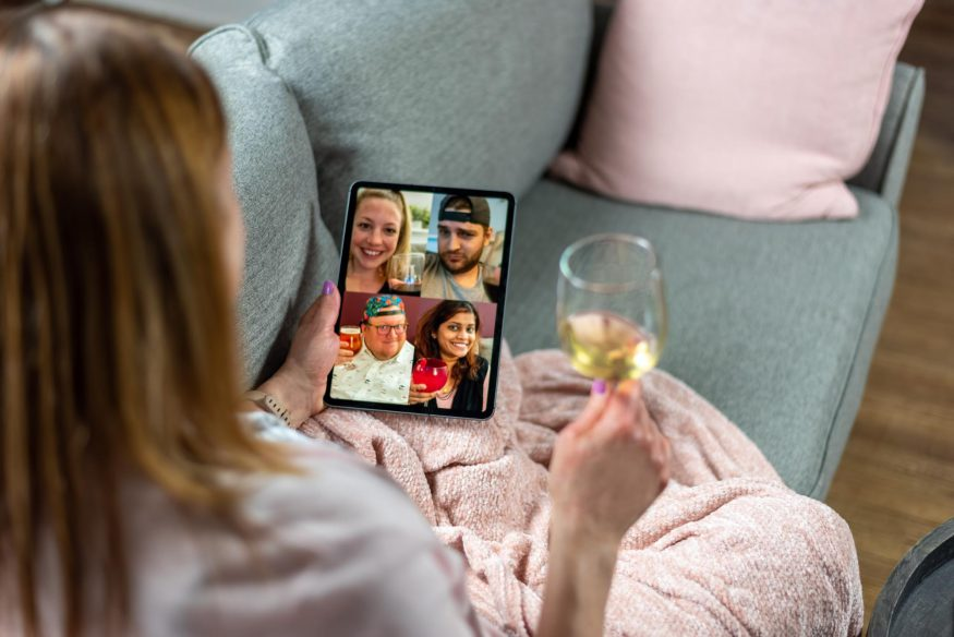 Woman having a virtual happy hour with her friends