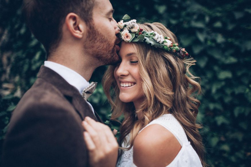 save the date postcards: Groom giving his smiling bride a forehead kiss