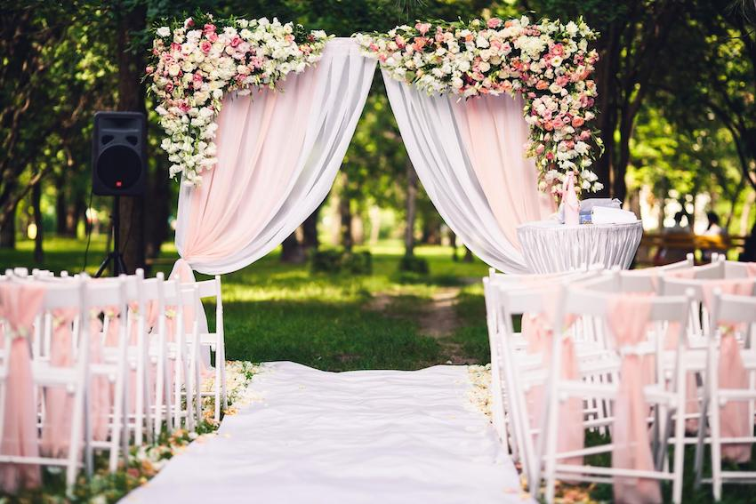 Garden wedding aisle with pink and white motif