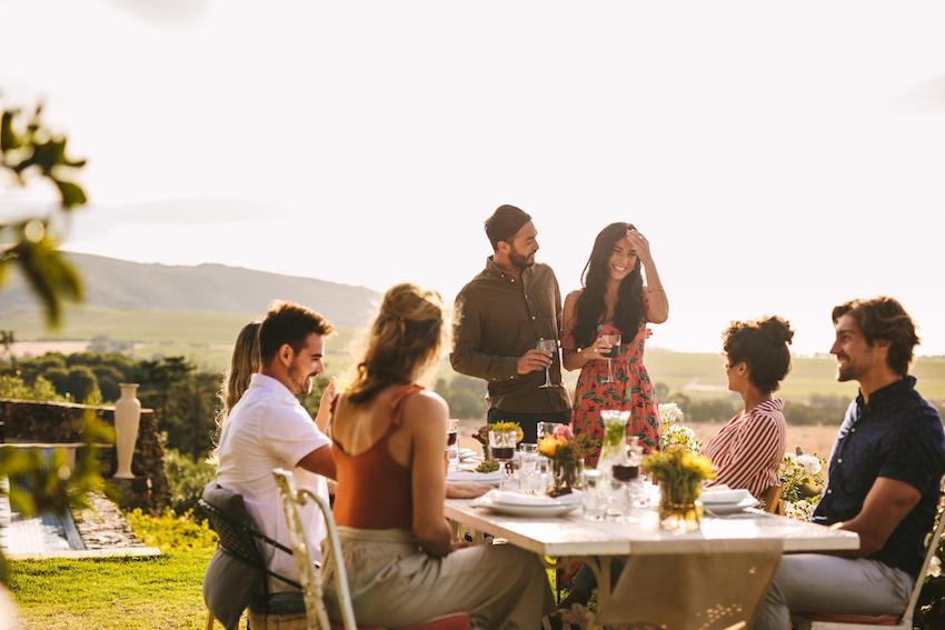 group of people having a meal outside