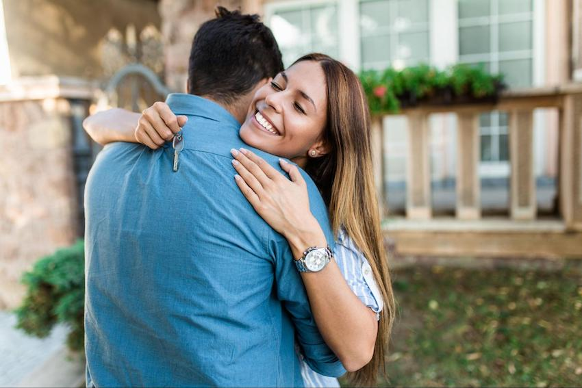 congratulations on your new home: woman hugging a man