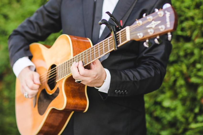 Man in suit playing guitar
