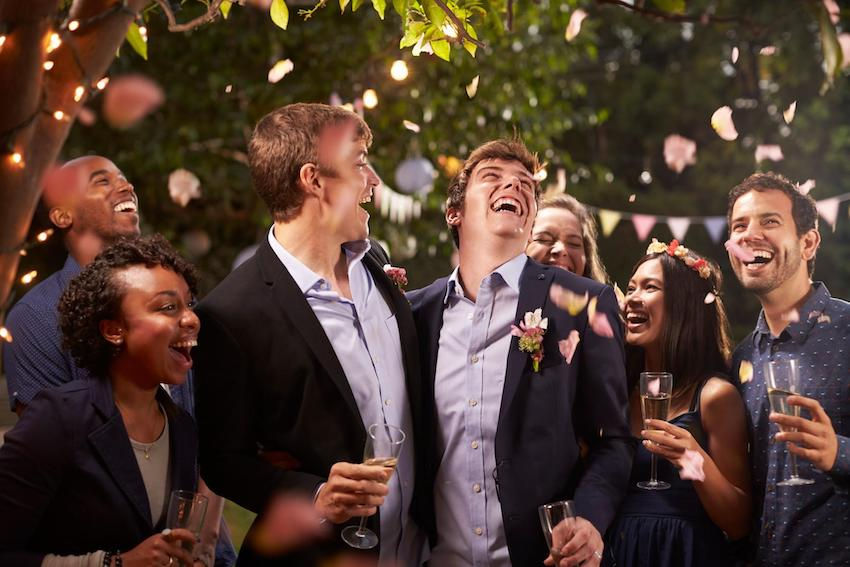 backyard wedding reception: newlywed with their friends partying