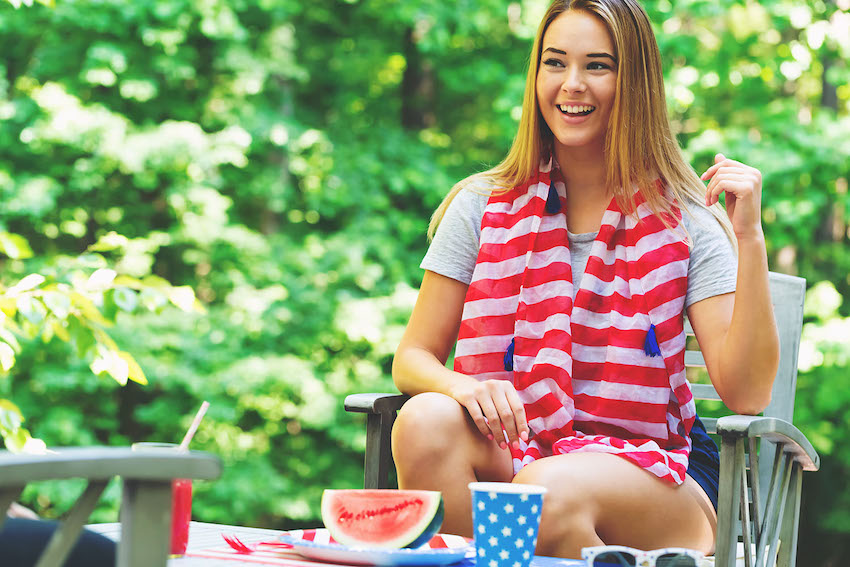 Memorial Day decorations: woman sitting outside with a watermelon on the table