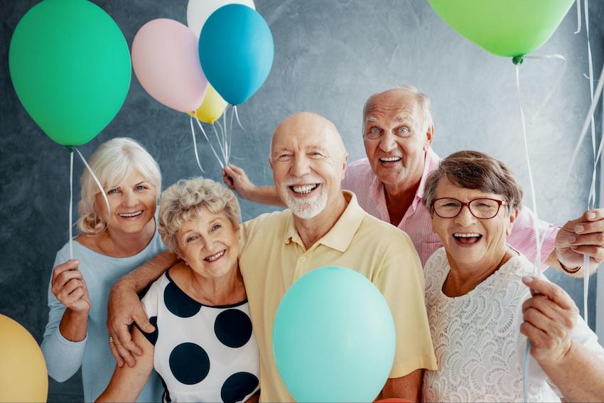 congratulations on your retirement: group of happy retired people holding balloons