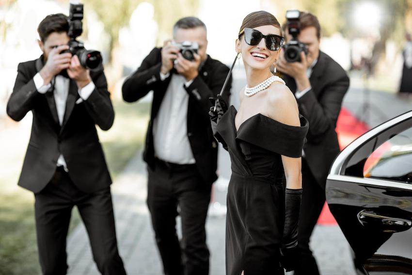 Hollywood theme party: Photo reporters photographing actress arriving on the awards ceremony