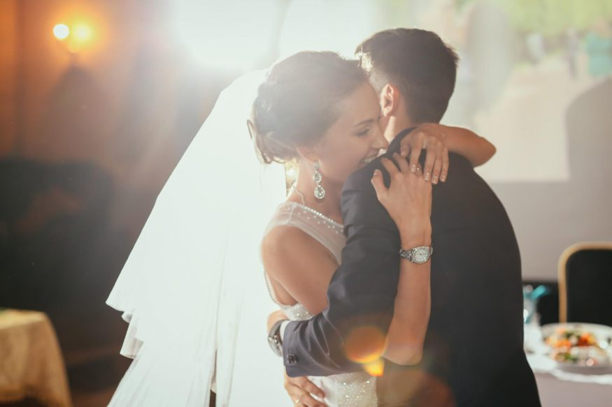 intimate wedding: Bride and groom hugging each other