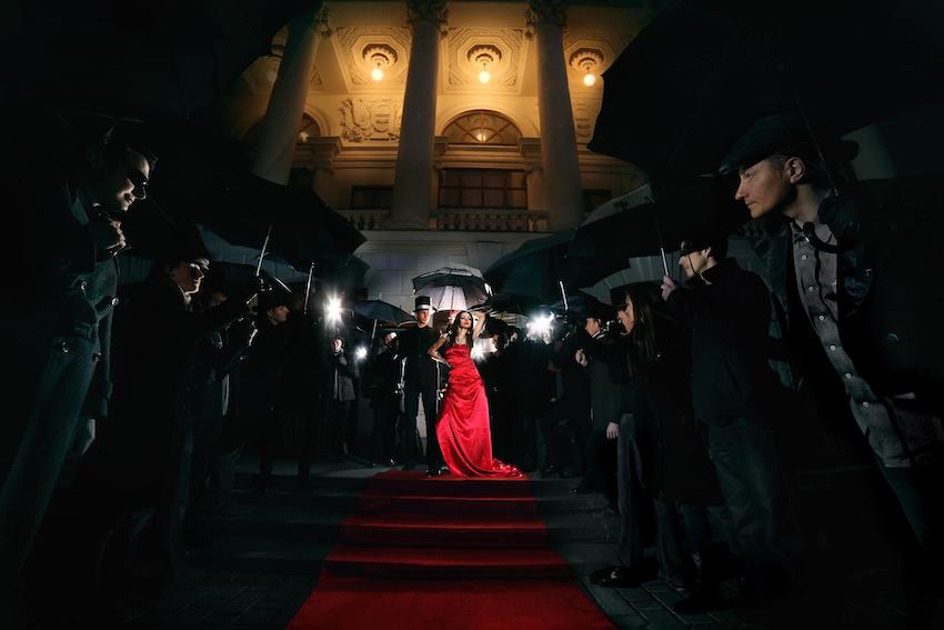 Hollywood theme party: Lady in red dress on the red carpet
