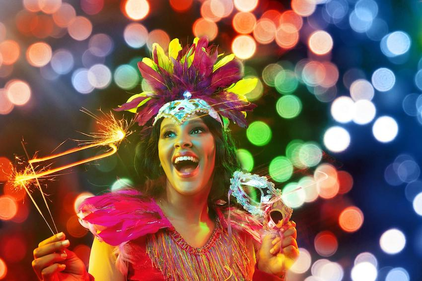 Mardi Gras decorations: Woman in carnival mask and stylish masquerade costume