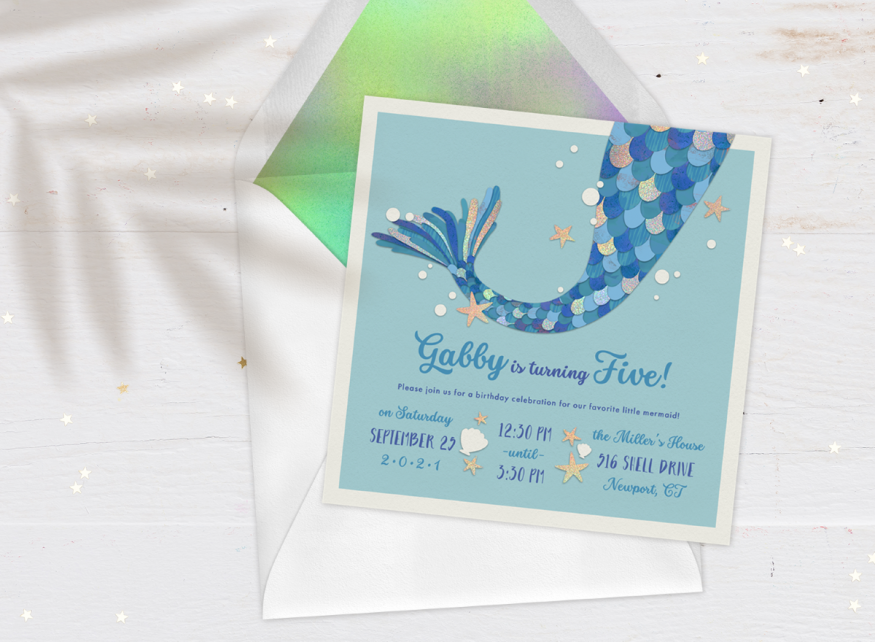 mermaid theme party: Mermaid Magic Invitation against a white, wooden background
