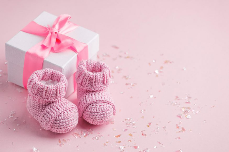 Pair of small baby socks with gift box
