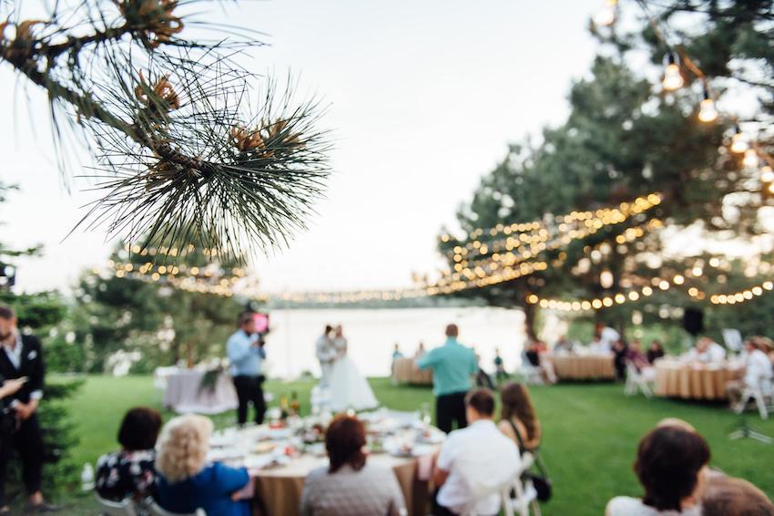 blurred image of a backyard wedding reception