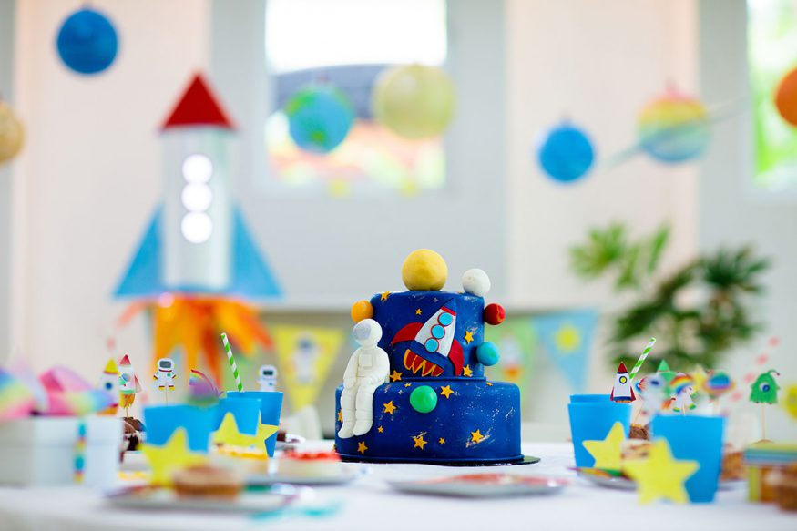 space themed party cake and decorations