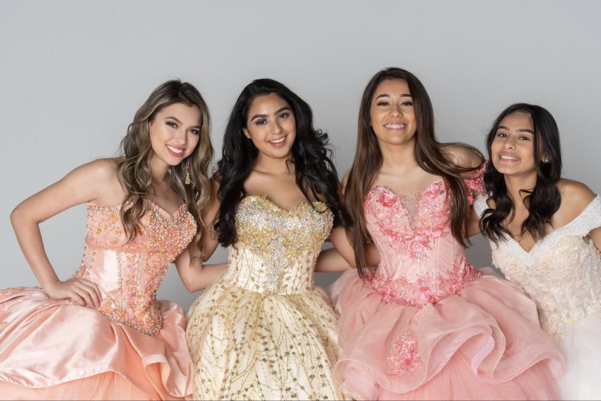 quinceanera gifts: Group of girls wearing gowns and smiling at the camera