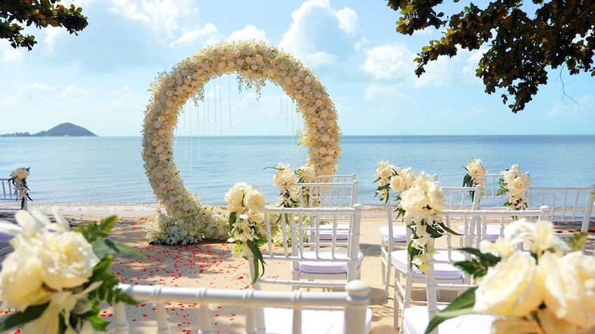 destination wedding ideas: wedding arch on the beach