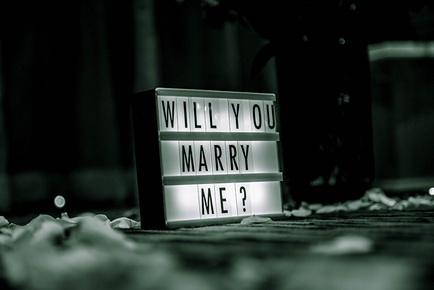 """letter board reading """"will you marry me""""?"""