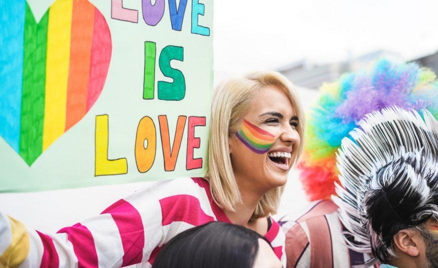 celebrating Pride: woman smiling at a Pride parade