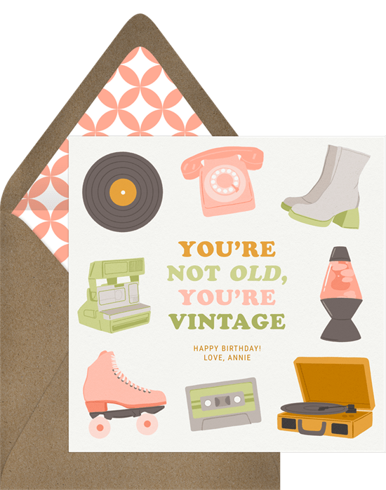 """Sweet and modern birthday card. The card features mod hand-drawn illustrations of a record player, a telephone, a lava lamp, platform boots, roller skates and more. The birthday message reads, """"You're not old, you're vintage."""""""